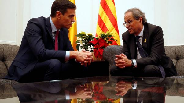 Spanish prime minister agrees with Catalan leader on easing political tension