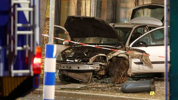 Woman killed after car ploughs into bus stop in Germany - Bild