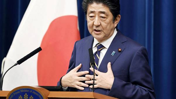 Japan's Cabinet approves record $900 billion budget, aims to soften sale tax blow