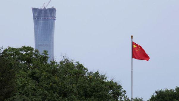 "China denies ""slanderous"" economic espionage charges from U.S., allies"