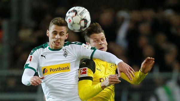 Dortmund beat Gladbach 2-1 to restore nine-point lead