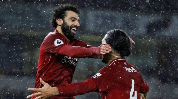 Liverpool seal Christmas top spot as Salah and Van Dijk sink Wolves