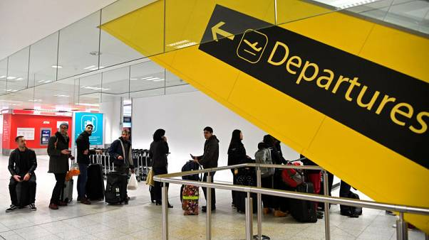 Police arrest man and woman over Gatwick drone disruption
