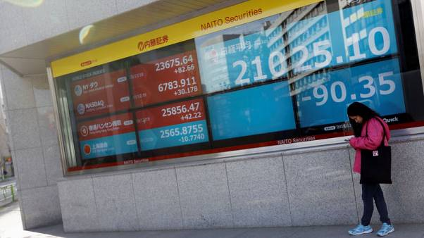 Asian markets a reluctant spectator to U.S. political theatre