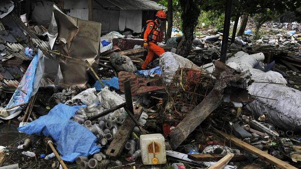 Indonesian rescuers use drones as tsunami death toll tops 400