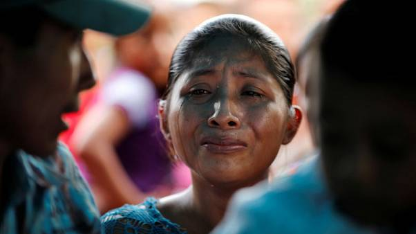 Guatemalan girl's Christmas funeral too much for grieving mother