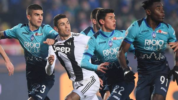 Substitute Ronaldo saves 10-man Juve's unbeaten record