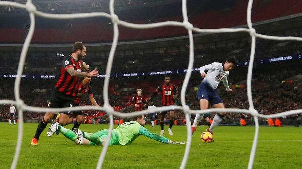 Super Spurs rout Bournemouth to move up to second