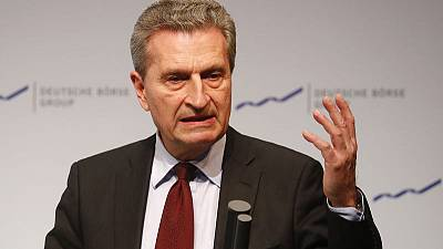 EU's Oettinger urges France to push budget deficit below 3 percent from 2020