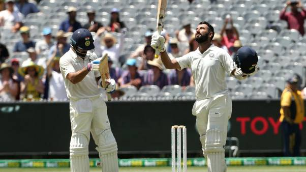India bats dominate Australia in scorching Melbourne