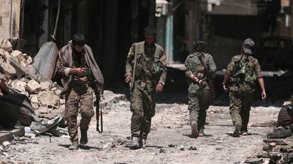 Let down by U.S., Syrian Kurdish leaders look to Russia and Assad