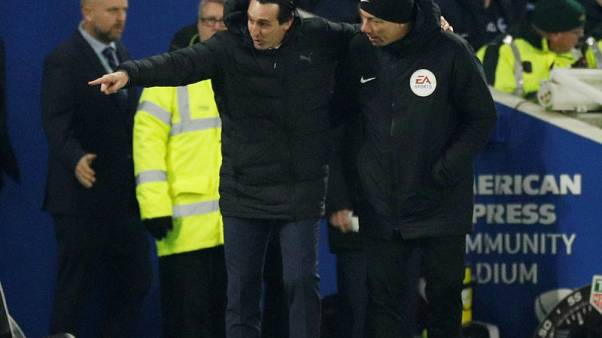 Arsenal's Emery charged over kicking bottle at fan