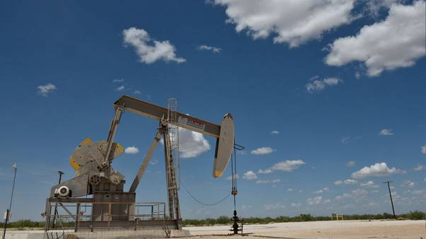 U.S. oil claws back some ground, but oversupply worries persist