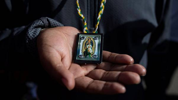 For many migrants trekking to the U.S., faith is their compass