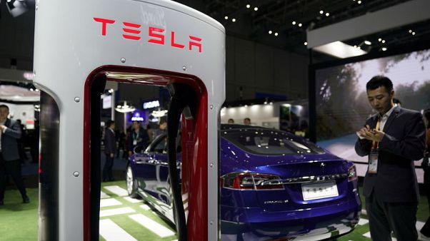 Tesla names Larry Ellison, Kathleen Wilson - Thompson to board