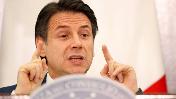 Italy PM defends budget as tempers fray in parliament