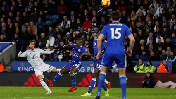 Cardiff earn first away win with late Camarasa strike at Leicester