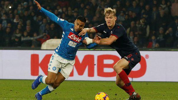 Mertens gives Napoli last-gasp win against brave Bologna