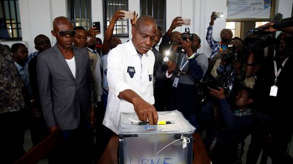 Storms, delays blight start to Congo's presidential vote