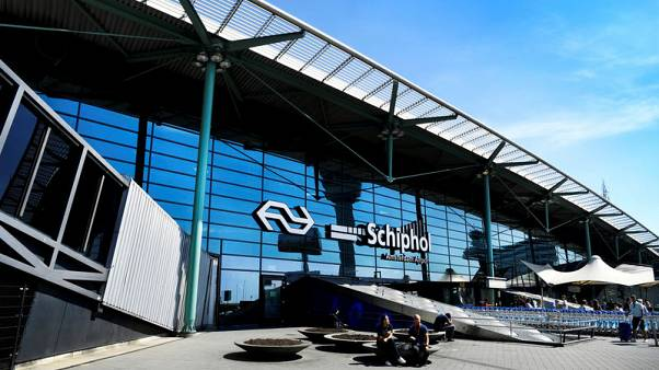 Man held at Amsterdam airport after bomb threat, departure hall reopens