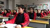 China says pace of Xinjiang 'education' will slow, but defends camps