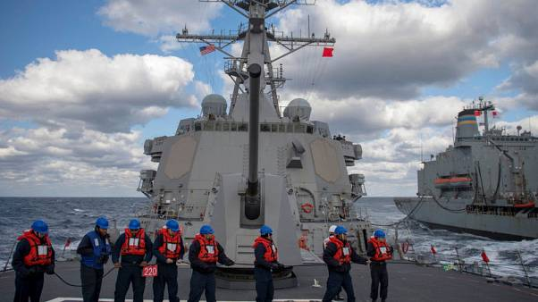 U.S. destroyer sails in disputed South China Sea amid trade talks