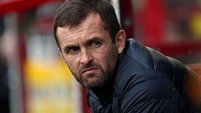 Stoke eye Luton boss Jones to replace Rowett - club