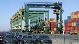 At China port, tariff drop a salve for hard-hit traders of American cars