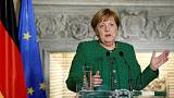 Merkel says Greece entering new era, reforms must continue