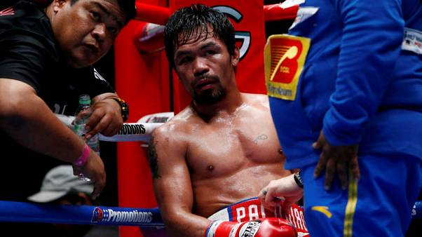 Boxing - Pacquiao takes jab at Mayweather over New Year's Eve cakewalk