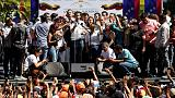 Venezuela opposition leader Guaido addresses rally after brief detention