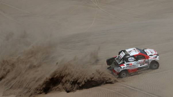 Rallying - Loeb wins another stage as Al-Attiyah stretches Dakar lead