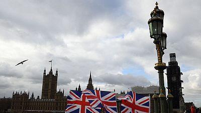 UK parliament to reject May's EU divorce deal, say economists