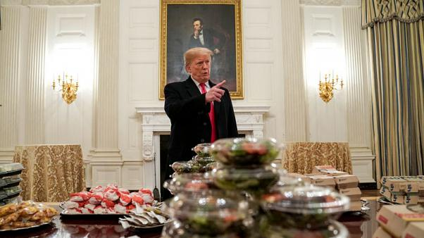 Burgers by candlelight - Trump lays out fast food for college football champs