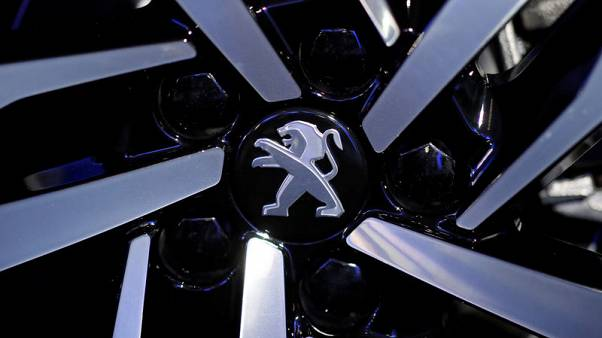 PSA Group sales hit record on Opel purchase, emissions chaos