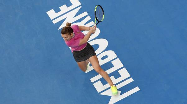 Determined Halep survives Kanepi hurdle to reach second round