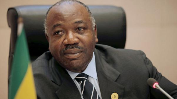 Back from medical leave, Gabon president appears in wheelchair