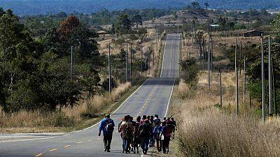 U.S.-bound Honduran migrant caravan grows as Trump argues for wall