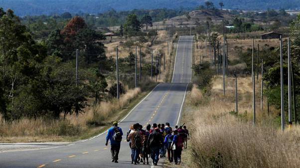 U.S.-bound Honduran migrant caravan grows as Trump argues for wall