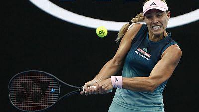 Kerber wins battle of left-handers to progress to third round