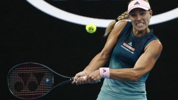 Kerber wins battle of left-handers to progress to third round