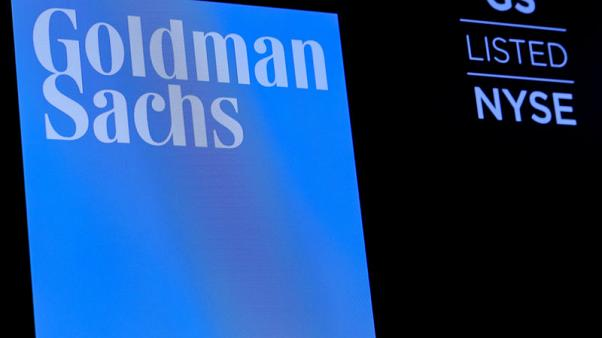 Goldman Sachs reports higher trading revenue, shares jump