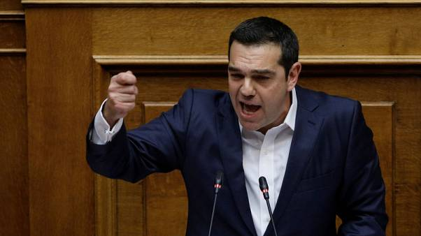 Greek PM Tsipras wins confidence vote, eyes Macedonia accord