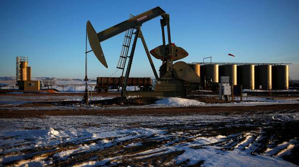 Record U.S. crude production weighs on oil prices