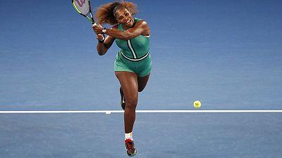 Serena Williams comfortably beats Bouchard to move into third round