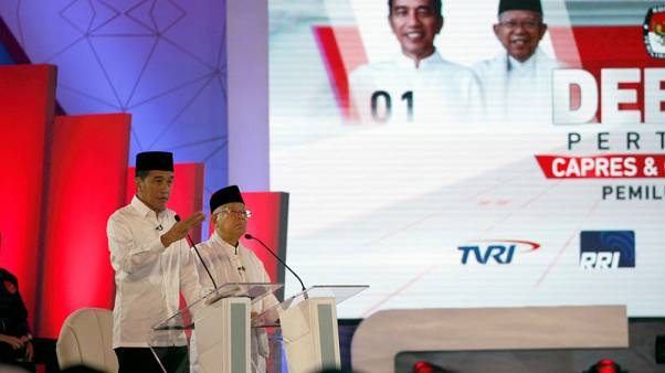Indonesian presidential candidates spar over corruption, law in debate