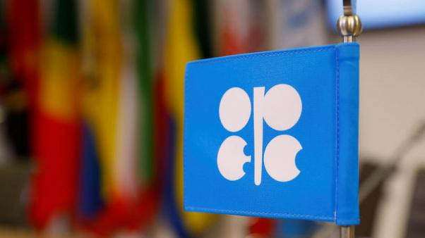 OPEC sees oil market not yet out of woods, tries to avoid new glut