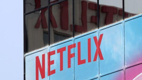 Netflix's fourth-quarter revenue misses estimates; shares slip