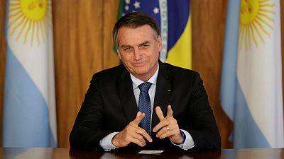 Brazil's Bolsonaro pledges action to 'restore democracy' in Venezuela