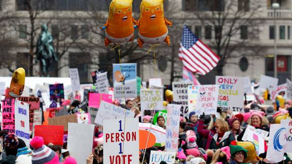 Women march in hundreds of U.S. cities for third straight year
